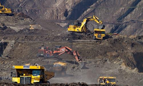 excavators digging in quartz rock quarry